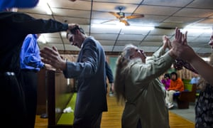 Church of the Lord Jesus member Justin Fletcher is anointed with oil as Nancy Kennedy whirls in a trance at a church in West Virginia.