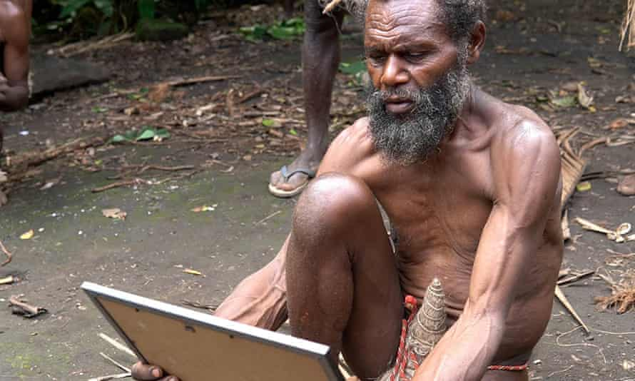 Chief Albi of Yakel village on Tanna stares at a portrait of Prince Philip