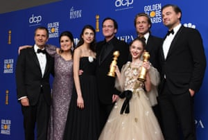 David Heyman, Shannon McIntosh, Margaret Qualley, Quentin Tarantino, Brad Pitt, Julia Butters, and Leonardo DiCaprio pose with the award for best motion picture musical or comedy for Once Upon A Time In Hollywood