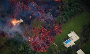 Lava from a robust fissure eruption on Kilauea's east rift zone consumes a home, then threatens another, near Pahoa