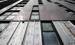 Cladding is removed for testing from one of the tower blocks in Salford City