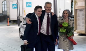 Antti Rinne, centre, leaves an election party with his wife, Heta Ravolainen-Rinne, and an assistant.