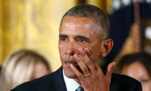 President Barack Obama wipes away tears while talking about Newtown and other mass shootings