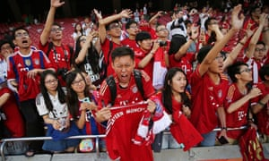 Chinese Bayern Munich fans cheer at a training session at the Bird's Nest stadium in Beijing