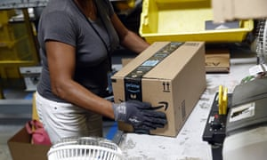 An Amazon worker handles a package