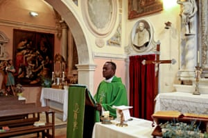 A priest conducts Sunday mass in the church