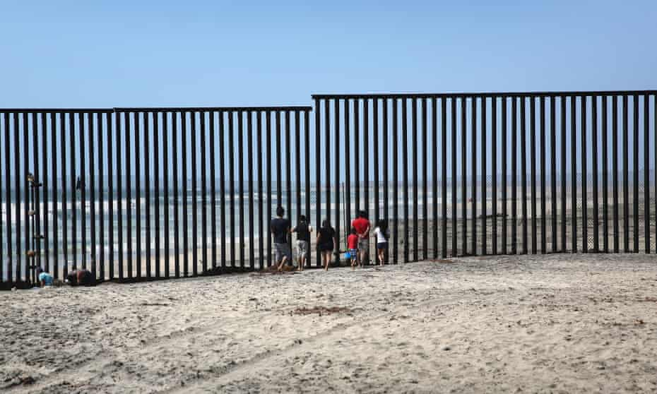 Mexicans meet separated family members through the US-Mexico border fence in Tijuana.