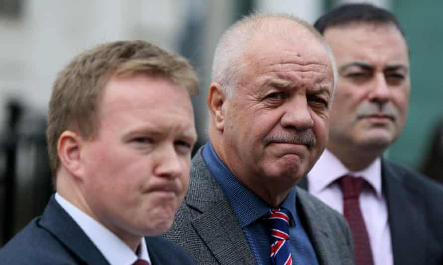 Victims' campaigner Raymond McCord (C) and solicitors Ciaran O'Hare (L) and Paul Farrell outside court after the judge dismissed their case.