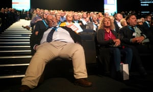 Party members at the Tory conference. One man seems to have taken posture advice from Jacob Rees-Mogg.