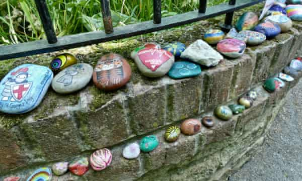 The snakes of painted stones got longer and longer as people added their contributions (Wantage, Oxfordshire).