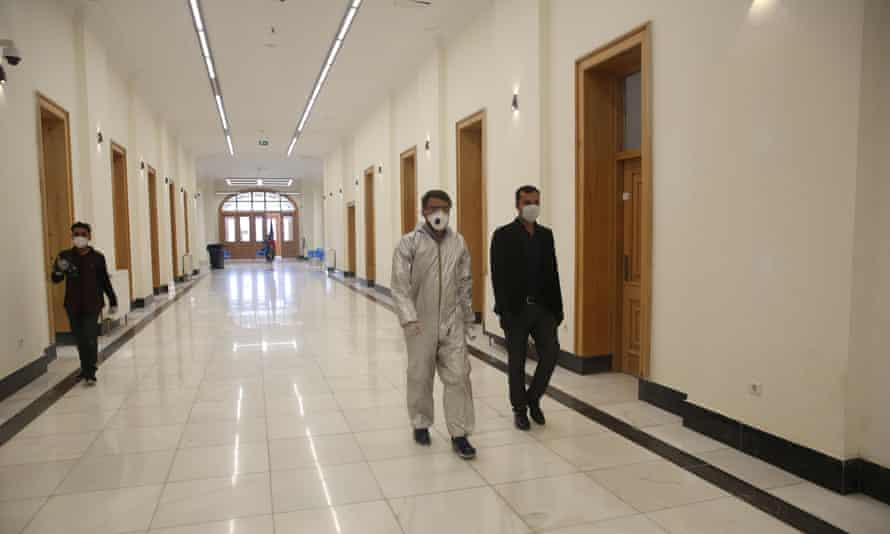 Doctors, wearing face masks, at 150-room Darul Aman Palace in Kabul, which has been turned into a hospital to treat coronavirus victims.