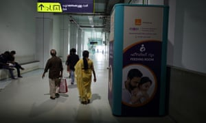 Passengers walk past a breastfeeding pod at Aluva metro station in Kochi