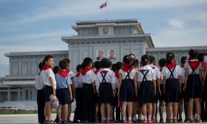 North Korean school children stand before the portraits of Kim Il-sung and Kim Jong-Il at the Kumsusan Palace of the Sun mausoleum in Pyongyang.