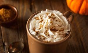 A pumpkin spice latte with cream and cinnamon.