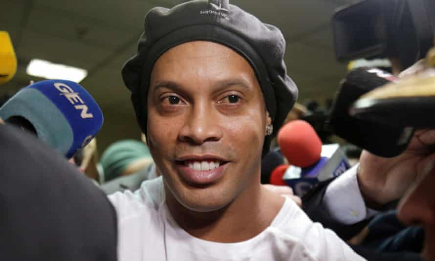 Football star Ronaldinho leaves Paraguay's supreme court on Thursday before his arrest the following day.