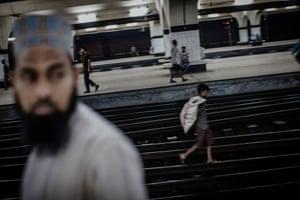 A child who lives on the streets walks along the tracks of Kamalapur station