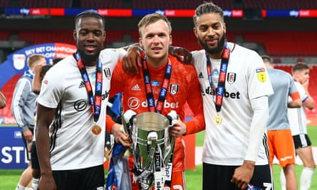 (Left to right) Josh Onomah, goalkeeper Marek Rodak and Michael Hector celebrate at Wembley on Tuesday after clinching promotion to the Premier League.