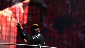 Hamilton celebrates on the podium.