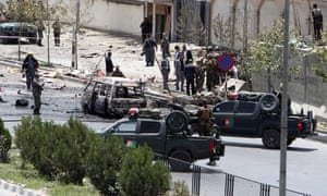 Afghan Police secure the scene of an attack by Taliban militants at the Afghan Parliament, in Kabul.