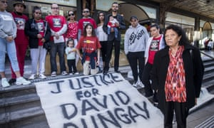 Leetona Dungay (right) the mother of David Dungay Jrn who died in Long Bay Correctional Centre stands with family outside the Downing Centre Courts in Sydney, Tuesday, July 17, 2018. The two-week inquest into the death of the 26-year-old Aboriginal man from Kempsey, while in custody at Long Bay Hospital, began in July 2018 but could not see all of the witnesses called and was delayed until March 2019.