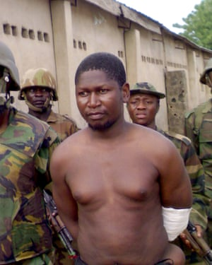 Mohammed Yusuf, then leader of Boko Haram, after his capture by Nigerian troops in 2009.