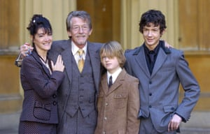 John Hurt receiving his CBE, with his wife, Anwen Rees Myers, and sons, Nicholas and Alexander, at Buckingham Palace in 2004