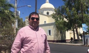 Father Prisciliano Peraza, a Catholic priest and migrant advocate, in front of Altar's church.