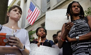 Activists attend a rally in support of the Black Lives Matter movement in front of the justice department in Washington.