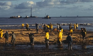 Workmen clean up after an oil spill in Santa Barbara, California in 1969.
