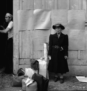 Centerville, California, 1942. This evacuee stands by her baggage as she waits for evacuation bus. Evacuees of Japanese ancestry will be housed in War Relocation Authority centers for the duration.