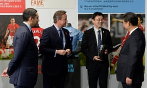 Xi Jinping (right) and David Cameron (left) introduced to former Manchester City player Sun Jihai (centre) by Manchester City chairman Khaldoon Al Mubarak at the City Football academy.