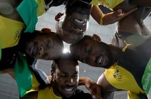 Jamaica's Usain Bolt, Asafa Powell, left, Yohan Blake, bottom, and Nickel Ashmeade, right, savour their victory.
