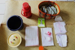 Her bag contains: – new clothes– cotton wool– alcohol for cleaning– nappies– flask– bucket– sanitary pads