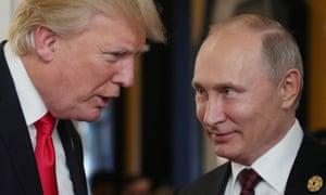 Donald Trump chats with Vladimir Putin in Danang, Vietnam last November.