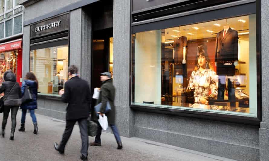 People walk past a store of British luxury brand Burberry in Zurich