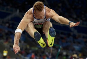 Greg Rutherford competes in the long jump.