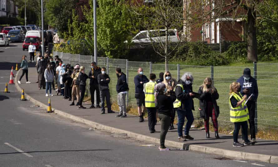 People queue to get a Covid vaccine in Bolton on 18 May.