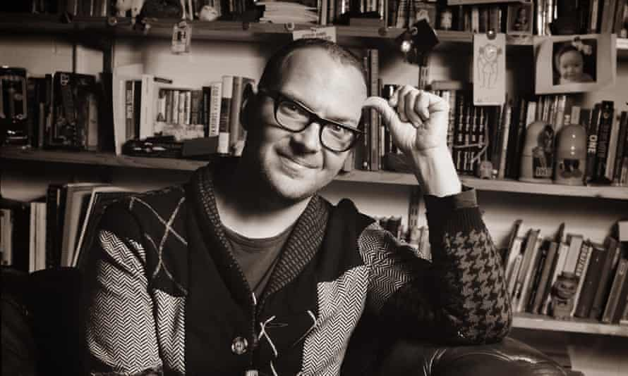 cory doctorow seated in an armchair in his office
