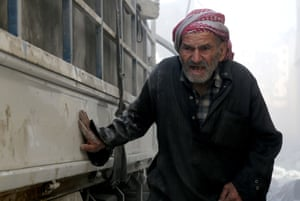A man in al-Sukkari district after Syrian military jets bombarded the area
