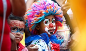 Children in makeup at a carnival in Caracas, Venezuela