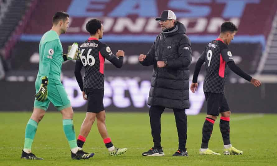 The Liverpool manager, Jürgen Klopp, celebrates with Trent Alexander-Arnold after the 3-1 win against West Ham at the London Stadium.
