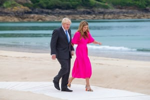 Boris and Carrie Johnson stroll down the boardwalk to the leaders' official welcome at the G7 summit in Carbis Bay, Cornwall