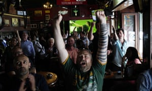 South African fans react to their team scoring as they watch a match in Johannesburg.