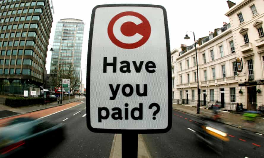 A road sign marks the start of the congestion charge area in London