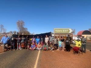 People block entry to Uluru-Kata Tjuta national park to visitors from coronavirus hotspots on 3 August.