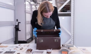 Melbourne Museum senior curator Deborah Tout-Smith inspects the small leather suitcase into which Ward placed the memorabilia of his war.