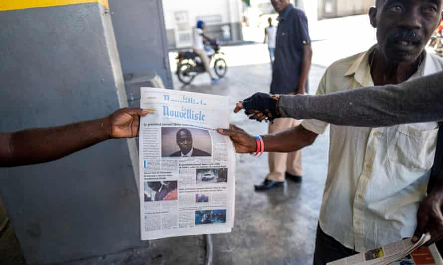 A newsagent sells local newspapers with news of the assassination of President Jovenel Moïse, in Port-au-Prince.