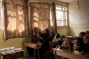 Raqqa: In the Aftermath of ISISStudents are seen in class at the heavily damaged Hawari Bu Medyan School, in Raqqa, Syria. May 2018. The school is located opposite a building that was used by ISIS's religious police, the Hisba, and was also the site of intense fighting during the offensive to retake the city from the extremist group. The school reopened in January 2018.