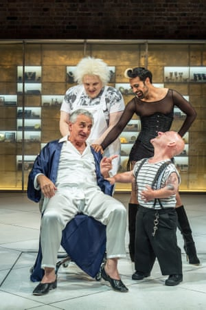 Volpone, 2015. Directed by Trevor Nunn, designed by Stephen Brimson Lewis. The photograph shows Volpone (Henry Goodman), Castrone (Julian Hoult), Androgyno (Ankur Bahl), Nano (Jon Key).
