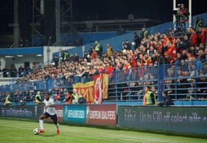 England's Raheem Sterling cuts inside on the left in front of the Montenegro fans.